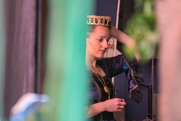Kendra Braunger, playing the role of Queen Eleanor in the play Robin Hood, adjusts her crown before going onstage for a scene in the second act during a dress rehearsal at Lincoln Community Center on Tuesday. Photo by Jackson Forderer