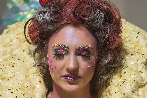 Megan Svalland as Lord Licorice, waits to take the runway at the RAW Fusion fashion show. Svalland modeled for PerfecTan and had candy sprinkles affixed to her eyebrows. Photo by Jackson Forderer
