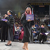 Diana Paola Gamboa Vega walks across the stage showing off her new degree from the Department of Educational Studies at one of three commencement ceremonies held at Bresnan Arena on the Minnesota State University campus on Saturday. Photo by Jackson Forderer