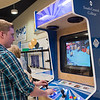 "Chris Wenner, a former South Central College student, plays ""Michael Jackson's Moonwalker"" on an arcade console during an graduation open house at the college on Thursday. All of the mechatronics students have a job lined up following their graduation. Photo by Jackson Forderer"