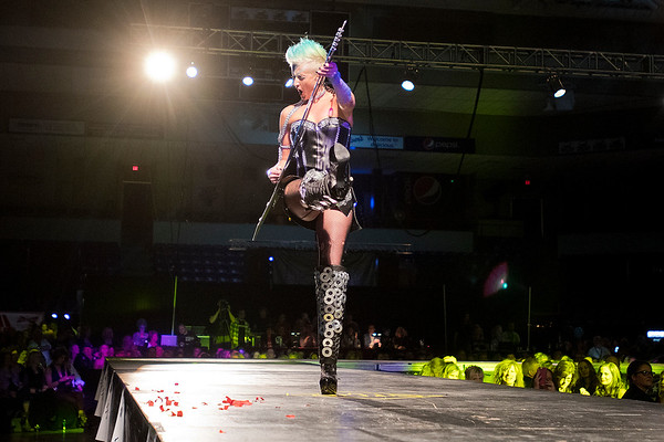 Jennifer Mueller kicks her leg in the air as she walks down the runway during the 7th annual Raw Fusion fashion show. Mueller won the Founders Favorite award for her outfit. Photo by Jackson Forderer