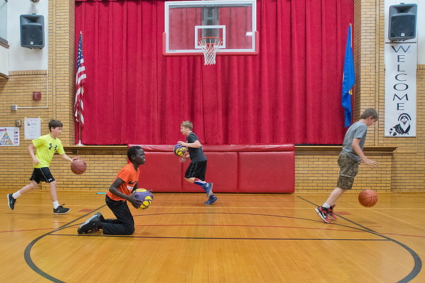 Fifth-grade Roosevelt Elementary students dribble basketballs with their left hand during an exercise as instructed by Minnesota State women's basketball coach Emilee Thiesse. Thiesse was at Roosevelt for Career Day on Friday. Photo by Jackson Forderer
