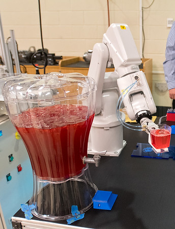 A robotic arm programmed by South Central College mechatronic students serves up punch during an open house at the college on Thursday. All of the mechatronic students were placed into jobs following their graduation. Photo by Jackson Forderer