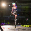 Jennifer Mueller of Condux International kicks her leg in the air while walking the runway at the 7th annual Raw Fusion fashion show held at the Verizon Center. Mueller won the Founders Favorite award for her outfit. Photo by Jackson Forderer