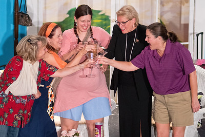 From left, Cindy Olson, Christie Smith, Lisa Noll, Carol Rath and Laura Conn make a toast to each other during a dress rehearsal of the comedy The Dixie Swim Club at the Lincoln Community Center on Tuesday. Photo by Jackson Forderer