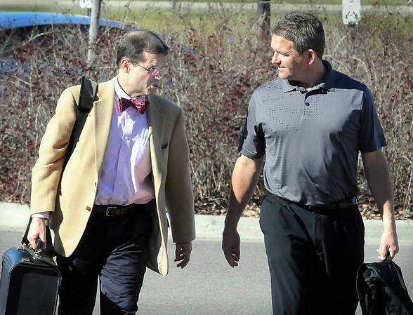 Minnesota State University head football coach Todd Hoffner (right) talks with attorney Jim Fleming as they arrive for a hearing Wednesday at the Blue Earth County Justice Center.