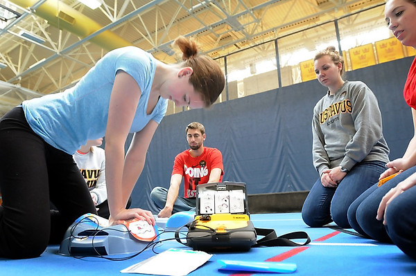 Gustavus Adolphus freshman Sammy Reichel works on CPR simulator during a training session Thursday to learn that procedure along with the use of an automatic defibrillator.<br /> The sessions to train up to a thousand Gusties and staff were the result of student Joe Thayer's efforts to make AEDs more accessbile around the campus.