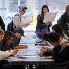 John Cross<br /> Minnesota State University students fill out voter registration forms while others wait in line to vote Tuesday at the Precinct 6 poll in the Margaret Preska Residential Community.