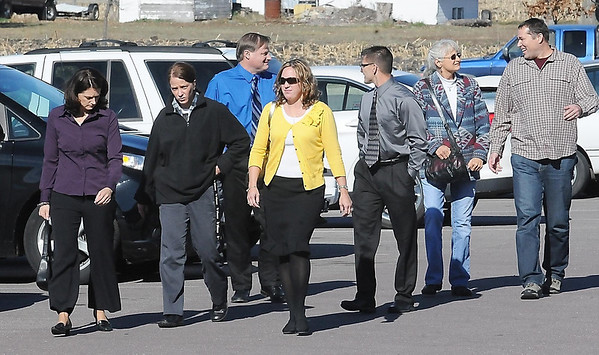 Friends and family of Minnesota State head football coach Todd Hoffner, including his wife Melodee (far left) arrive at the Blue Earth County Justice Center before Hoffner's hearing Wednesday.