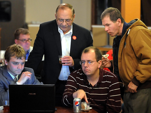John Cross<br /> From left, Joel Hanson, Republican congressional candidate Allen Quist, Bill Paulsen and Joel Brude check out early election results at a gathering Tuesday in downtown Mankato.