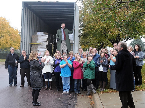 Pat Christman<br /> Books for Africa founder Thomas Warth (right) and executive director Patrick Plonski (in trailer) talk with Capstone Publishing employees before a truck full of the last of more than 220,000 donated books is shipped to Africa Wednesday outside the company's North Mankato office.