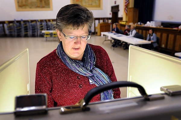 John Cross<br /> Cindi Baker, an election judges at Precinct B at Franklin School, took a few moments from her official duties to vote in Tuesday's election.