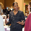 Pat Christman<br /> YWCA national CEO Dara Richardson-Heron talks to visitors before speaking at the YWCA Women's Leadership Conference Wednesday at the Verizon Wireless Center.