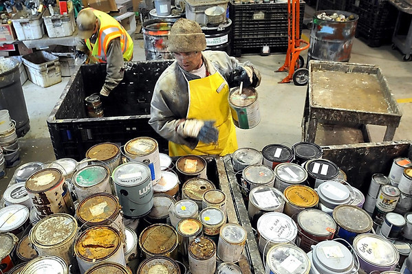 Pat Christman<br /> Ken Frederick sorts through paint cans brought into the Mankato Household Hazardous Waste facility on it's last day for the year Tuesday.