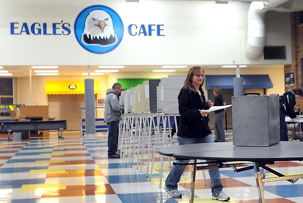 Pat Christman<br /> A voter casts her ballot during Tuesday's election at Maple River High School in Mapleton.