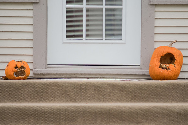 Two rotting pumpkins on a doorstep along Garfield Ave. in North Mankato. Both cities of Mankato and North Mankato accept pumpkins as organic compost. Photo by Jackson Forderer