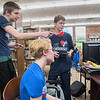 Maxwell Keyes (left), 18, points at the screen while he played the Nintendo Switch game Mario Kart 8 with Emily Lynch (center), 16, and Josh Miller, 14, at the Waseca Library on Saturday. A group of gamers played video and board games for 25 hours to raise money for the charity Extra Life. Photo by Jackson Forderer
