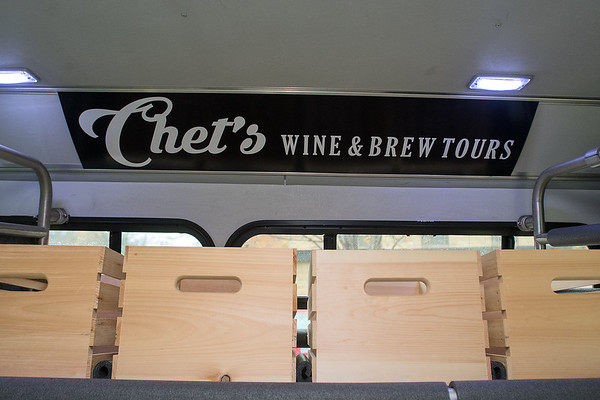 Crates inside the Chet's Wine and Brew Tours bus are for people to store their purchased items in. Drinking is not allowed on the bus, but Natasha Chester said that plenty of fun will be had at each stop. Photo by Jackson Forderer