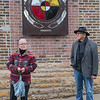 "Gwen Westerman (left) and Glenn Wasicuna, both Dakota elders, give their remarks during an unveiling of a piece of artwork titled ""Land of Memories"", located in the alleyway behind Friesen's Bakery. Wasicuna also lead a prayer in the Dakota language as a blessing for the new piece of artwork. Photo by Jackson Forderer"