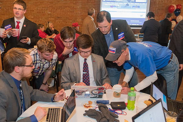District 1 Republicans including Jeremy Munson (upper right) look at election results as they trickled in at the Mankato Event Center on Tuesday evening. Munson (who  won his race of House District 23B) and others were keeping a close eye on the razor thin House District 1 race between Jim Hagedorn and Dan Feehan. Photo by Jackson Forderer