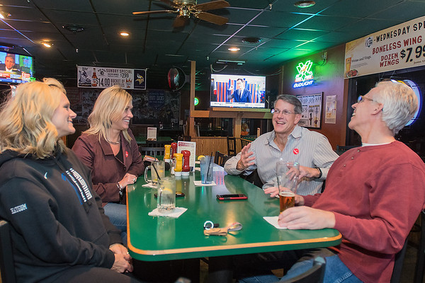 Mark Dehen celebrates his re-election victory with friends Craig Hartman (right), Pam Haugum (left) and wife Kim Dehen at Big Dog Sports Cafe in North Mankato on Tuesday night. Photo by Jackson Forderer