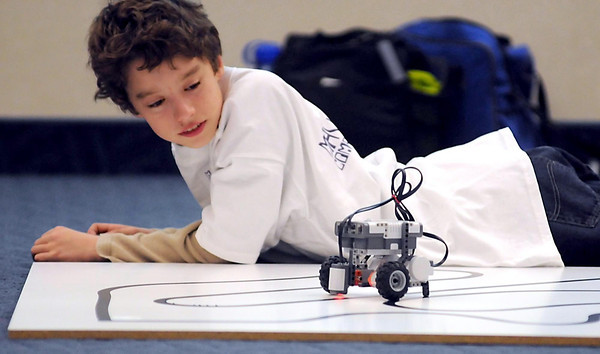 Christian Garcia Hublein, 12, watches as he tests his robot during the MavBot competition Saturday at Minnesota State University.