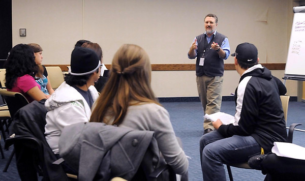 James Bonilla, an associate professor at Hamline University's School of Business, speaks to a small group during one of the breakout sessions at the Multicultural Affairs Conference Thursday at Minnesota State University.