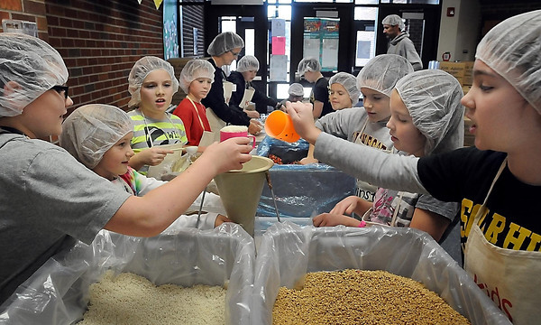 John Cross<br /> Students at the Eagle Lake Elementary School team up Monday to assemble meals for Kids Against Hunger.