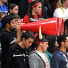 A Bethany Lutheran College fan uses his head to help support one of a pair of megaphones brought by his classmates during the men's basketball team's home opener against St. Olaf Thursday.