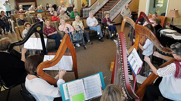 John Cross<br /> Members of an musical esemble led by harp instructor Marilyn Johnson treat residents at Monarch Meadows in North Mankato to a Pre-Holiday Harp and Viola Musicale on Tuesday.