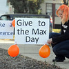 Pat Christman<br /> YWCA development and operations assistant Sam Ward put signs in front of the organization's building for Give to the Max day Thursday. A volunteer, staff or board member also painted their hair orange for each $500 donated.