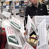 Mark Fischenich<br /> Minnesota State University student Ashley Walter looks at Holdiay Sharing Tree cards after the program's kickoff event Thursday at the Hilltop Hy-Vee.