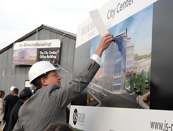 Pat Christman<br /> Profinium CEO Marques Doppler unveils the name of the Tailwind Group's new downtown office building, Profinium Place, during a groundbreaking ceremony Tuesday on the corner of Warren Street and Riverfront Drive.