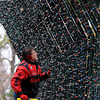 Pat Christman<br /> Lynn Austin checks lights on a lighted tunnel in Sibley Park Saturday.