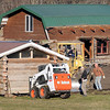 Pat Christman<br /> Volunteers help Jack McGowan (right) move one of 8 buildings used for the annual Historyfest away from the river on his land south of Mankato Thursday. The buildings are being moved to create a 1800s village and to comply with a federal order to clear the flood plain.