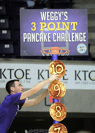 Pat Christman<br /> A Minnesota State University student puts up the last pancake on the Weggy's 3-point Pancake Challenge board after the men's basketball team made 10 3-point baskets during their win over Waldorf Friday at Bresnan Arena. All students in the student section received two free pancakes at the restaurant.