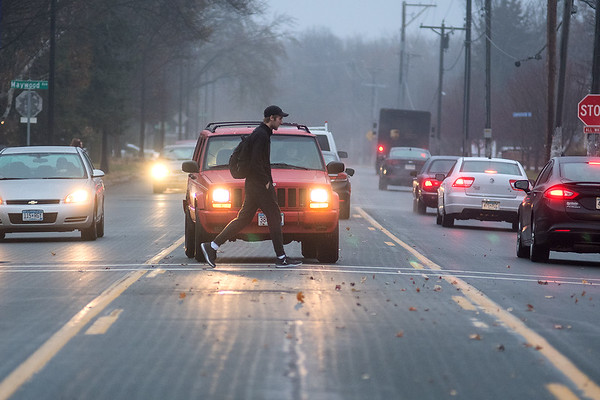A pedestrian crosses Warren Street from the Minnesota State University campus amidst traffic on Tuesday. Photo by Jackson Forderer