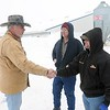 Rep. Tony Cornish talks with Blue Earth County hog barn owners Loren Schoenrock (center) and Chris Sonnek in late 2010. Cornish addressed environmental regulation after hundreds of hogs that died in a fire in a barn the two owned couldn't be buried without MPCA approval. File photo