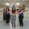 Violet Kind (right), owner of Satori Violet belly dancing studio, gives instruction to Talia Larson during a class at the dance studio. Photo by Jackson Forderer