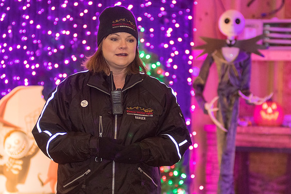 Shannon Gullickson talks about the new features at this year's Kiwanis Holiday Lights in the warming house at Sibley Park on Tuesday. Behind Gullickson is a Nightmare Before Christmas display, celebrating the movie's 25th anniversary. Photo by Jackson Forderer