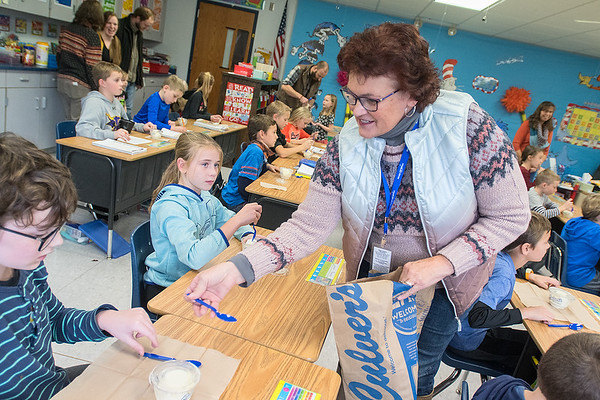 Carol De Kruif with the Make A Wish Foundation passes out ice cream to the fourth-grade class at Mt. Olive after announcing that Owen Saidler would be getting his wish granted to go to Disney World. Photo by Jackson Forderer