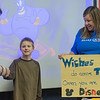 Owen Saidler (center), 9, shakes hands with Carol De Kruif of Make A Wish as she announced with Erica Flatin (right) that Owen's wish of going to Disney World was coming true. The announcement came as a surprise to Owen in front of fourth-grade classmates at Mt. Olive on Friday. Photo by Jackson Forderer