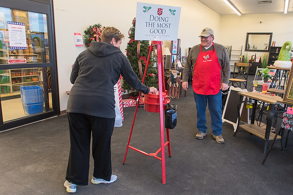Bill Vander Sluis (right) greets a customer at Hobby Lobby as she donated to the Salvation Army while heading out of the store on Thursday. Photo by Jackson Forderer
