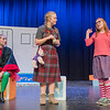 June B. Jones, played by Melisandra McLaughlin (right), talks to her classmate May, played by Mallory Rotchadl (center) during a dress rehearsal of Junie B. Jones in Jingle Bells, Batman Smells at Mankato West on Tuesday. Photo by Jackson Forderer