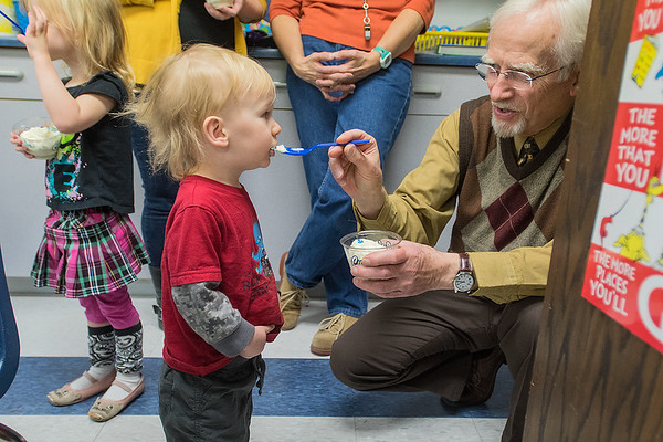 Finnegan Saidler, 1, is fed ice cream by Mt. Olive principal xxx as the Saidler family joined Owen's fourth-grade class for his Make A Wish surprise. Photo by Jackson Forderer