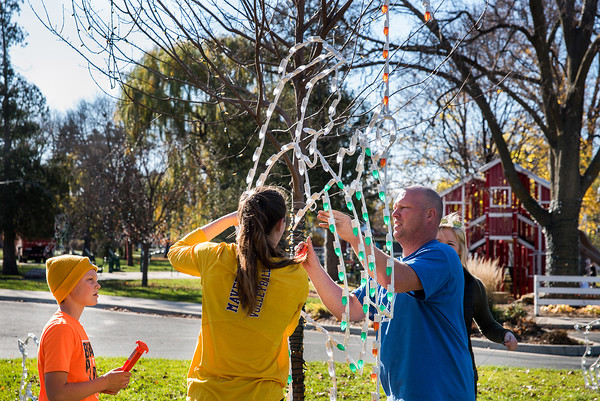 Ristion Wojcik (left) Sydney Powell (middle) Scott Wojcik (right) and Maddie Keute (far right) positioning and anchoring down one of the three wise men decorations for the Kiwanis Holiday Lights Sunday afternoon at Sibley Park in Mankato. Photo by Levi Janssen