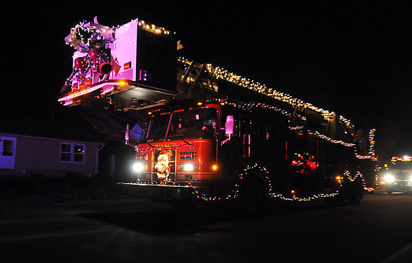 Pat Christman<br /> The Mankato Fire Department ladder truck leads the way during the Kiwanis Holiday Lights parade Friday.