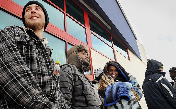 John Cross<br /> Jessie Morris (left) and Greg Bates, (second from left) arrived early Thursday to claim the first two spots in line at Best Buy which was scheduled to open on Thanksgiving Day at 6 p.m.