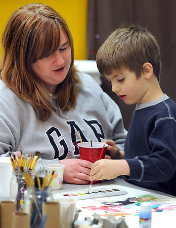 Pat Christman<br /> Angie Beaudoin watches her son Parker, 5, paint during Art Creation Day at the 410 Project in Mankato.