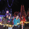 John Cross<br /> Viewers stroll along a  lighted candy-cane path to view the Kiwanis Holiday Liights display Friday at Sibley Park.